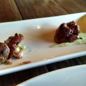 Grilled duck hearts over celery root puree.